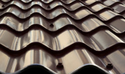 Dark metal roof tiles